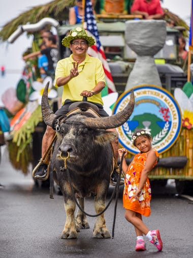 Esrae Aguon, 6, leads a carabao named Do'ak along with