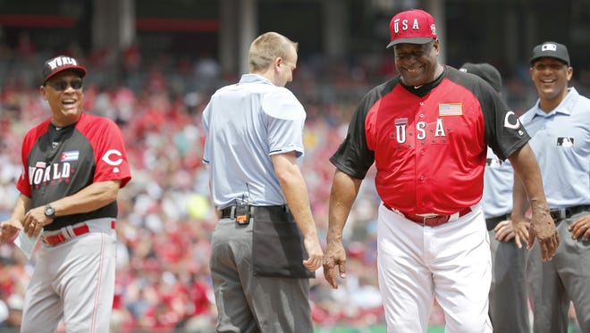 Reds greats Tony Perez, left, who was the manager of the World Team, and Ken Griffey Sr., right, who was the manager of the USA Team, share a laugh prior to the MLB Futures Game on Sunday.