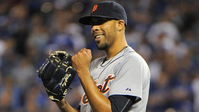 Detroit Tigers starting pitcher David Price (14) celebrates an out against the Kansas City Royals in the ninth inning at Kauffman Stadium. Detroit won the game 2-1.