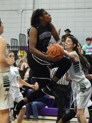 Jada Swafford (20, center) goes for two against Bowling Green Saturday.