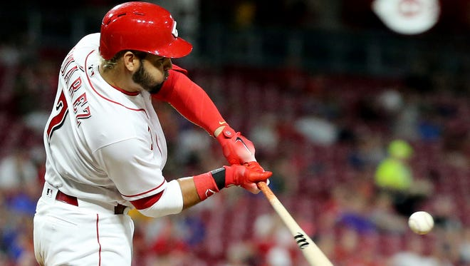 Cincinnati Reds third baseman Eugenio Suarez (7) singles in the seventh inning during a National League baseball game between the New York Mets and the Cincinnati Reds, Tuesday, May 8, 2018, at Great American Ball Park in Cincinnati. Cincinnati won 7-2.