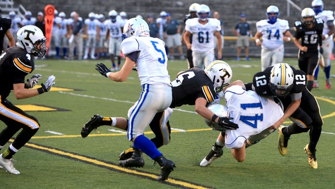 Zach Webster (12) leads the Tuscola football team in tackles.