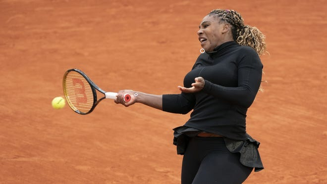 "Two days after getting past fellow American Kristie Ahn in her opening match of the French Open, Serena Williams withdrew Wednesday with an injured Achilles tendon. Williams said she needs a month or more now of ""sitting and doing nothing"" because of the Achilles, meaning her 2020 season is ""more than likely"" done."