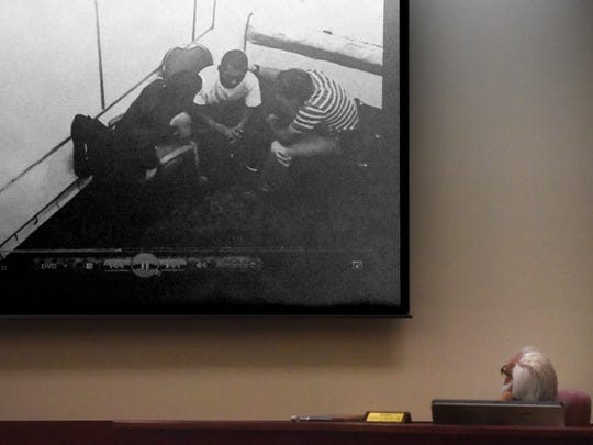 A video of San Juan County Sheriff's Office detectives questioning Cody Soto, center, plays during Soto's trial on a murder charge on Tuesday at the Eleventh Judicial District Court in Aztec. Judge John Dean watches in the foreground.