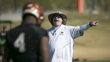 Rattlers head coach Kevin Guy coaches during the first day of Rattlers football camp at Copper Sky Recreation Complex in Maricopa on Tuesday, January 31, 2017.