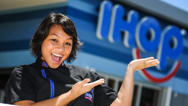 General Manager Breanalyn Meno poses for a photo outside the IHOP restaurant in Tamnuning on Monday, July 27 after the restaurant officially open its doors to customers. At the age of 22 years old, Meno is one of the youngest general managers in the national restaurant chain.