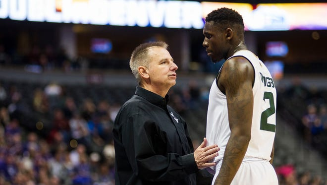 CSU basketball coach Larry Eustachy, who can win his 500th career game today when the Rams host Air Force, talks to forward Emmanuel Omogbo during a timeout in a Dec. 17 game in Denver against Kansas State.