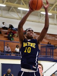Wayne's Keion Epps drives in for a layup.