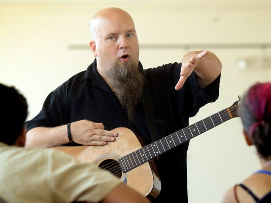 "Instructor Rod Goelz teaches a QuickStart Guitar lesson at Marketview Arts Tuesday, Sept. 8, 2015. The class is one of several hosted by Weary Arts Group. The free ""drop-in"" classes teach basics in various artistic fields and don't require regular attendance. Bill Kalina - bkalina@yorkdispatch.com"