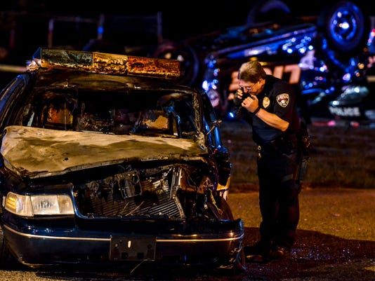 At least one York City Police officer was injured and transported to the hospital after two city cruisers collided at the intersection of  South Sherman and Edgar streets late Wednesday, Oct. 7, 2015. One cruiser ended up on its roof, the other burst into flames.