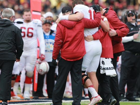 Stanford quarterback Keller Chryst is helped off the field after injuring his knee in the Sun Bowl on Dec. 30, 2016.