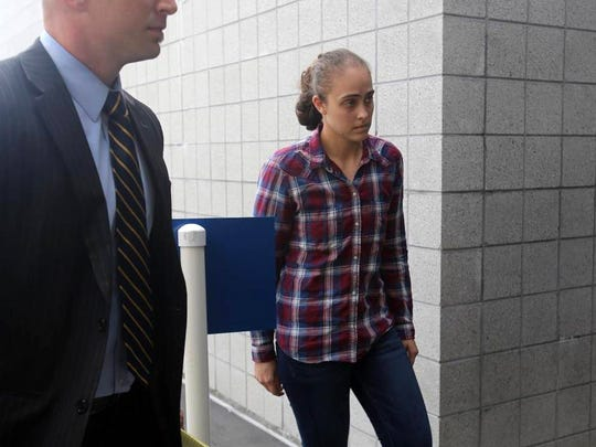 Former Long Beach Police Officer Cassie Barker arrives with her attorney, Donald Rafferty, to surrender on a manslaughter charge on Thursday, Oct. 6, 2016.