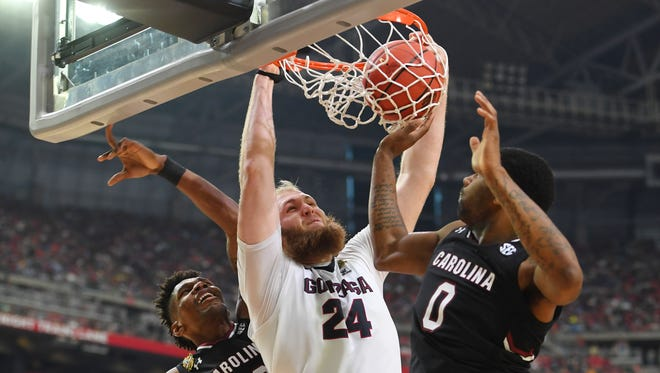 Gonzaga center Przemek Karnowski dunks between two South Carolina defenders in Saturday's semifinal victory.