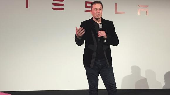 Elon Musk speaking to press