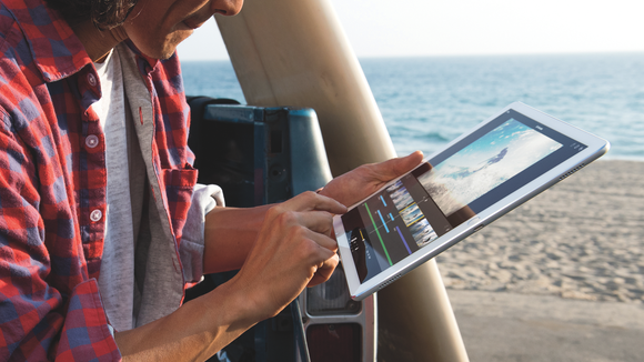 Person using iPad Pro on a beach