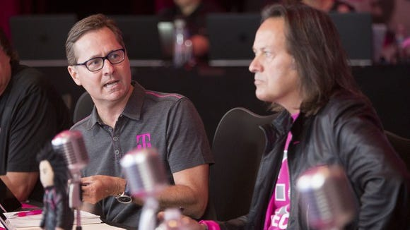T-Mobile COO Mike Sievert and CEO John Legere.