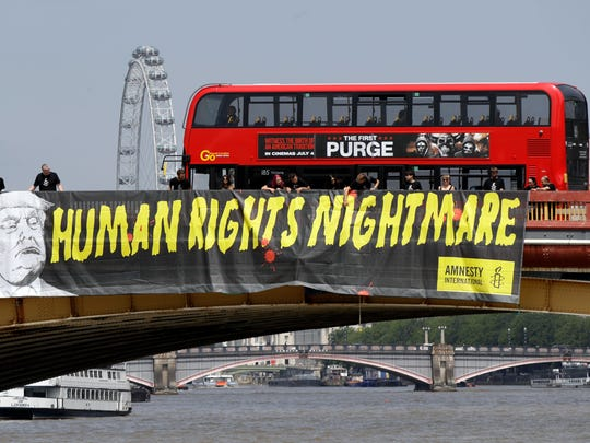 """A giant """"Human Rights Nightmare"""" banner is unfurled"""