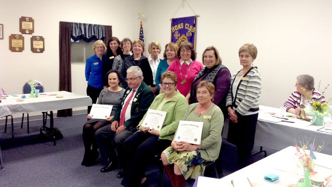 Pictured standing, from left, are: Kitty Miller, sponsor; State Rep. Kristin Phillips-Hill, new member; Kate Putt, new member; Anita Beck, sponsor; Peggy Alton, new member; Vicky Chaney, new member; Barbara Bick, sponsor; Andrea Rauls, sponsor; and Pat Bishard, sponsor. Seated, from left, are: Barbara Eschenour, new member; John Griffie, district governor of the Jacobus Area Lions Club; Gwen Coggeshall, new member; and Josephine Huber, new member.