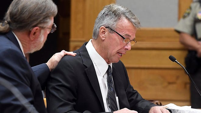 Attorney James Fleming puts his hand on David Pettersen's shoulder as Pettersen reads a statement during a sentencing hearing Tuesday, July 11, 2017, at the Watonwan County Courthouse in St. James, Minn. Pettersen who shot and killed an intruder who was fleeing from his home has been sentenced to 90 days in jail.