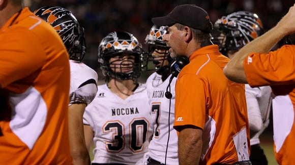 Nocona head football coach Brad Keck talks to his team during a timeout in the game against Holliday Friday, Oct. 13, 2017, in Holliday.