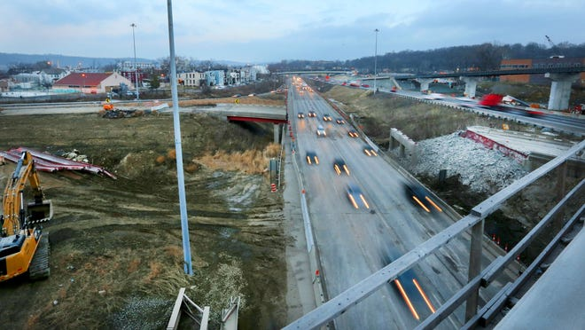 Interstate 75 southbound was reopened late Tuesday evening, in time for rush hour Wednesday morning after the Monday night bridge collapse killed one worker. The demolition of the old bridge, which collapsed, was part of the Hopple Street interchange project.