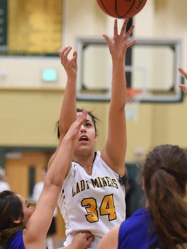 Action photos of the Carson at Manogue girls basketball