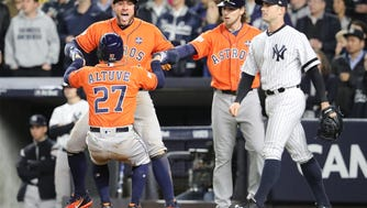 The Astros celebrate in the sixth inning Tuesday