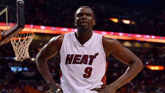 Luol Deng reacts after drawing a foul during the first half against the Orlando Magic at American Airlines Arena.