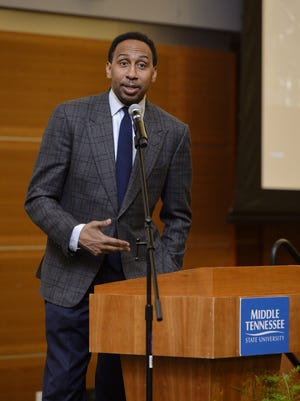 ESPN personality Stephen A. Smith speaks to a crowd at MTSU Wednesday night as the keynote speaker of the university's Black History Month celebration.