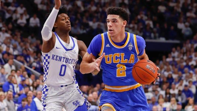Lonzo Ball (2) and UCLA beat De'Aaron Fox (0) and Kentucky on Dec. 3.