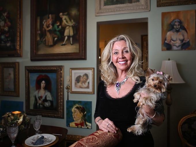 Darlene Metts and her puppy Bella inside her Saint James Court condo. Dec. 4, 2013