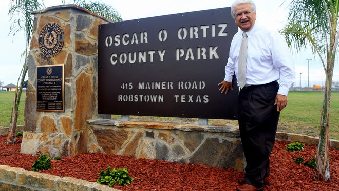 Oscar O. Ortiz stands next to the entrance sign of the Oscar O. Ortiz County Park that was dedicated to him Tuesday, Dec. 27, 2016, in Robstown.
