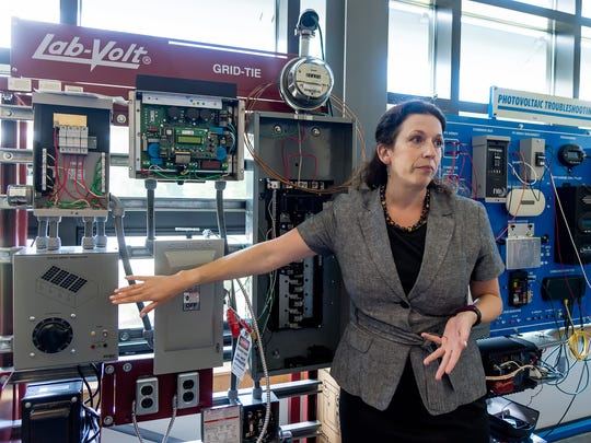 Jennifer Clemons, Delaware Technical Community College's department chairperson of energy technologies, explains some of the equipment mock-ups used in the Center for Energy Training and Education at the Terry Campus.