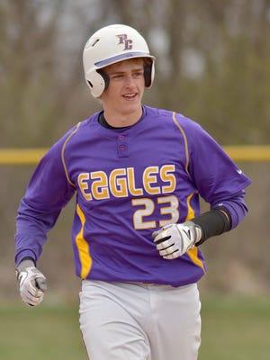 PCA's Josh Slater happily rounds the bases after hitting the first varsity home run of his career Thursday. He slammed a three-run shot over the fence in right field for the Eagles.