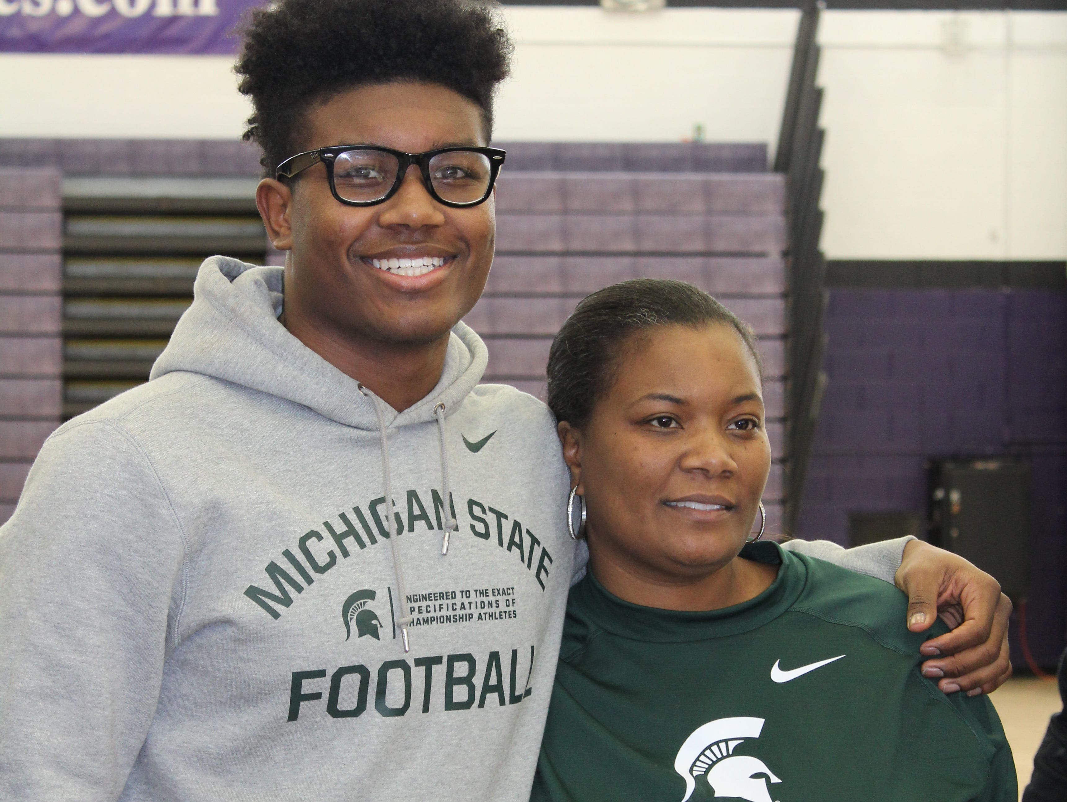 Pioneer High linebacker Antjuan Simmons, joined by his mom, Tawan, signed with Michigan State on Wednesday.
