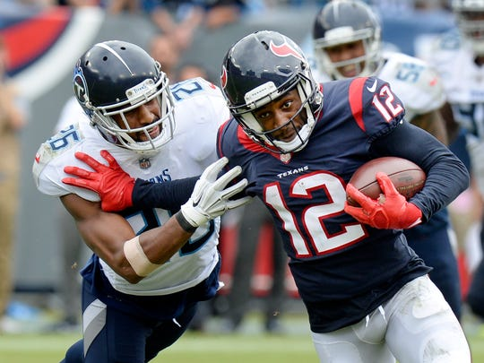 Houston Texans wide receiver Bruce Ellington (12) pushes his way past Tennessee Titans defensive back Logan Ryan (26) in the second half of an NFL football game Sunday, Sept. 16, 2018, in Nashville, Tenn. (AP Photo/Mark Zaleski)