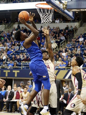 Pittsburgh Panthers forward Corey Manigault (11) rises to shoot against Florida State Seminoles guard Terance Mann.
