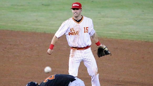 Fresno Grizzlies Preston Tucker, bottom, ducks as Chihuahuas