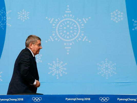 International Olympic Committee President Thomas Bach walks off stage after speaking at a news conference prior to the 2018 Winter Olympics in Pyeongchang, South Korea, Wednesday, Feb. 7, 2018. (AP Photo/Patrick Semansky)