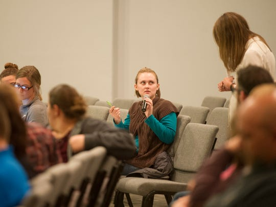 An attendee asks a question during an active shooter training at One Life East on Jan. 10.