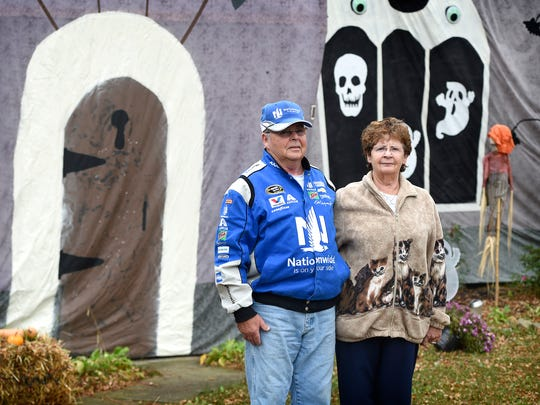 Meredith Miller (left), and Christine Miller (right) of 1816 Ashton Drive, in North Lebanon, stand in front of their house, which is fully decorated for Halloween.