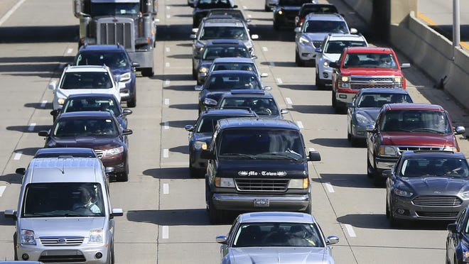 FILE- In a June 23, 2015, file photo, traffic heads north along the Lodge freeway in Detroit. Michigan drivers will have choices to make when they renew or buy a new auto insurance policy under a law taking effect Thursday, July 2, 2020. Motorist can buy unlimited personal injury protection, but it will no longer be mandatory.