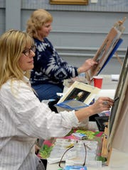Pastel art class students — and buddies beyond the easels — Jeanie Kelleher, left, and Valerie Bayer work side-by-side in Milford's SHAC. The pair often get together on the weekends at each other's homes to work on the craft too.