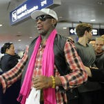 Former NBA basketball player Dennis Rodman of the US prepares to check in for his flight to North Korea at Beijing's international airport on January 6, 2014.  Rodman, who visited Pyongyang in December, will visit North Korea from January 6 to 10.       AFP PHOTO / WANG ZHAO        (Photo credit should read WANG ZHAO/AFP/Getty Images)