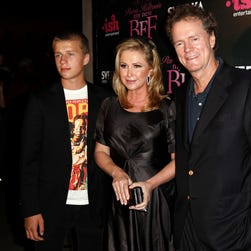 """In this Sept. 30, 2008, file photo, Conrad Hilton, left, Kathy Hilton, center, and Rick Hilton arrive at the launch party of new MTV series """"Paris Hilton's My New BFF."""""""