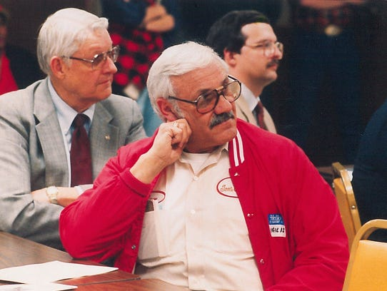 Tom Ceniglis Sr. attends a meeting in 1987.