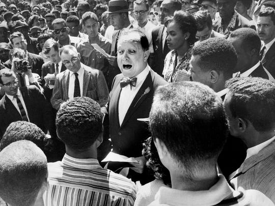 Nashville Mayor Ben West, center, shouts to be heard as he tells a crowd of black demonstrators that he intends to uphold the law, but that he also feels lunch-counter segregation is unjust April 19, 1960. On the scene of the courthouse steps, the Rev. C.T. Vivian, next to West's left, read a statement critical of the mayor and then debated with West.