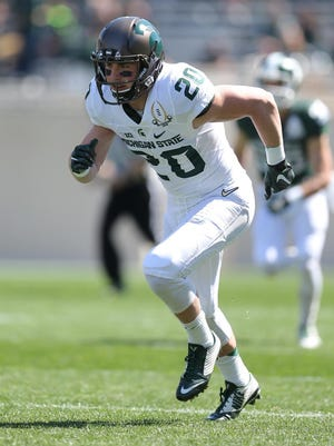 Davis Lewandowski played for the White team in the spring game Saturday.