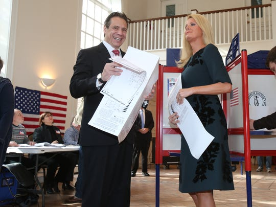 Gov. Andrew Cuomo and his girlfriend Sandra Lee vote Tuesday at the Presbyterian Church of Mount Kisco.