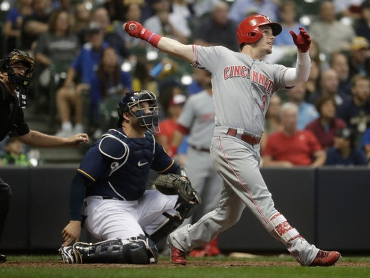 Former Brewers Scooter Gennett is Christian Yelich's chief competition for the NL batting title in 2018.